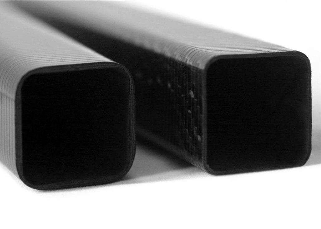 a pair of square carbon fibre tubes